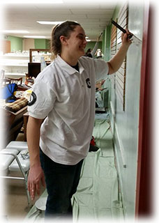 Americorps service members painting